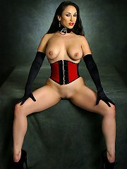 Brunette in corset gagged,..